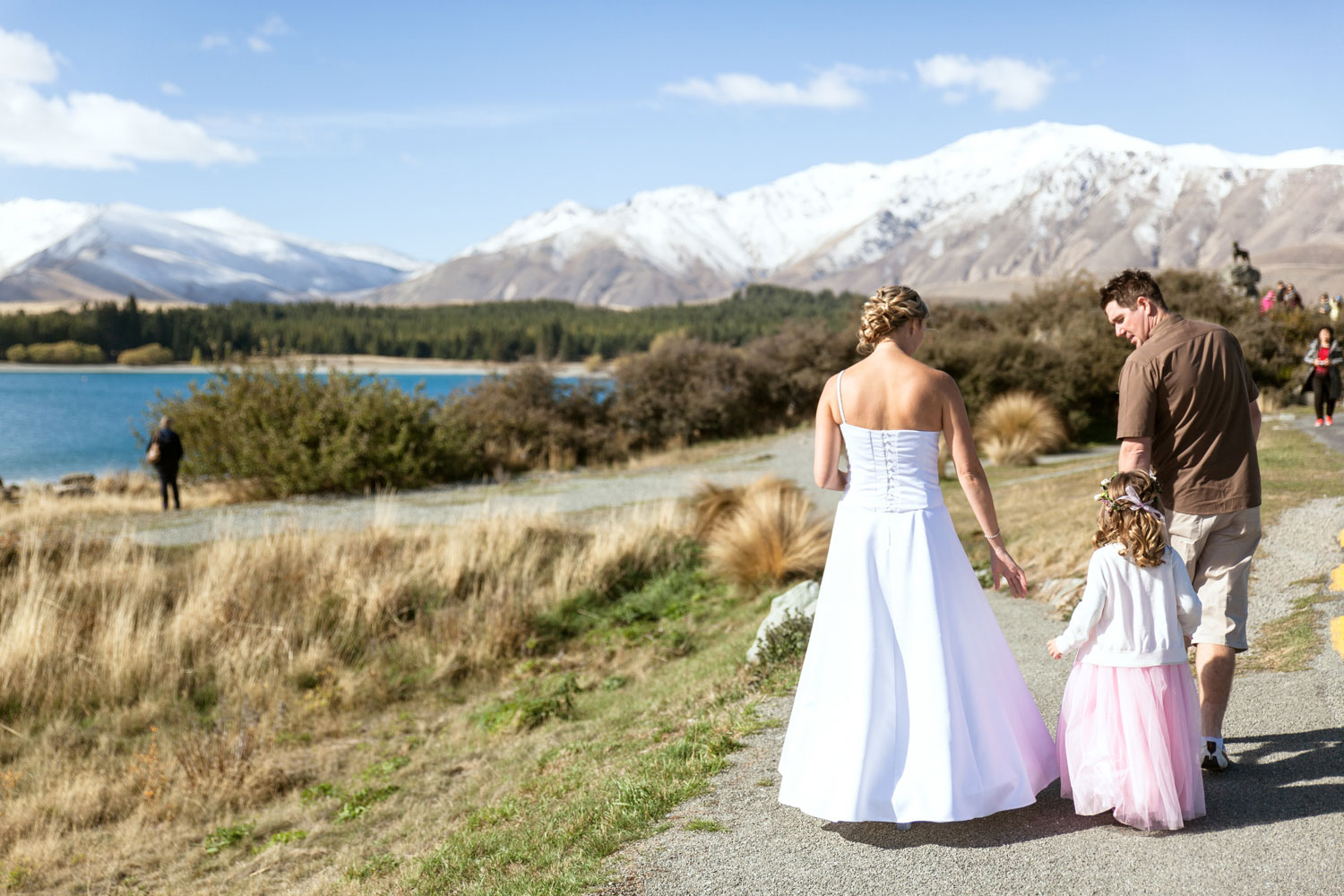 lake tekapo wedding couple and daughter