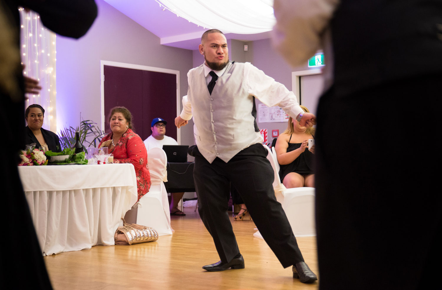 auckland wedding reception groomsman dancing