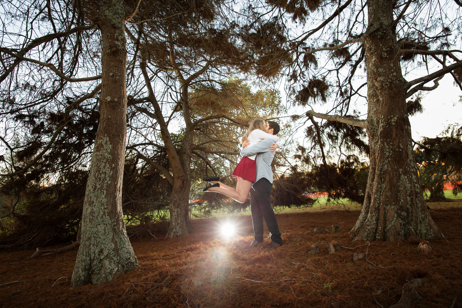 auckland engagement photo bride jumping up