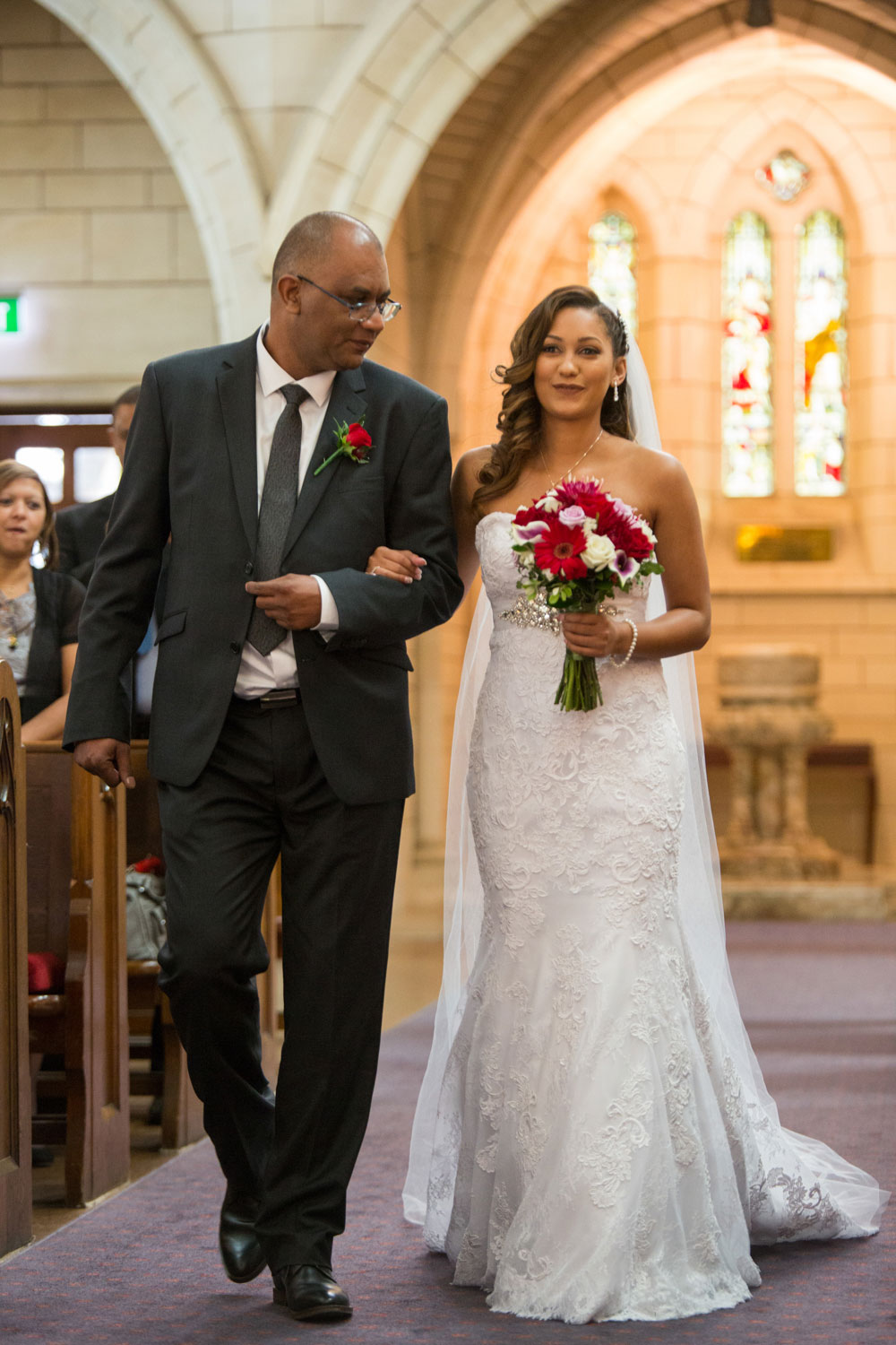 auckland wedding bride walking down the aisle