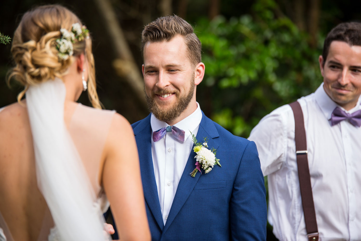 auckland wedding groom smiling at bride