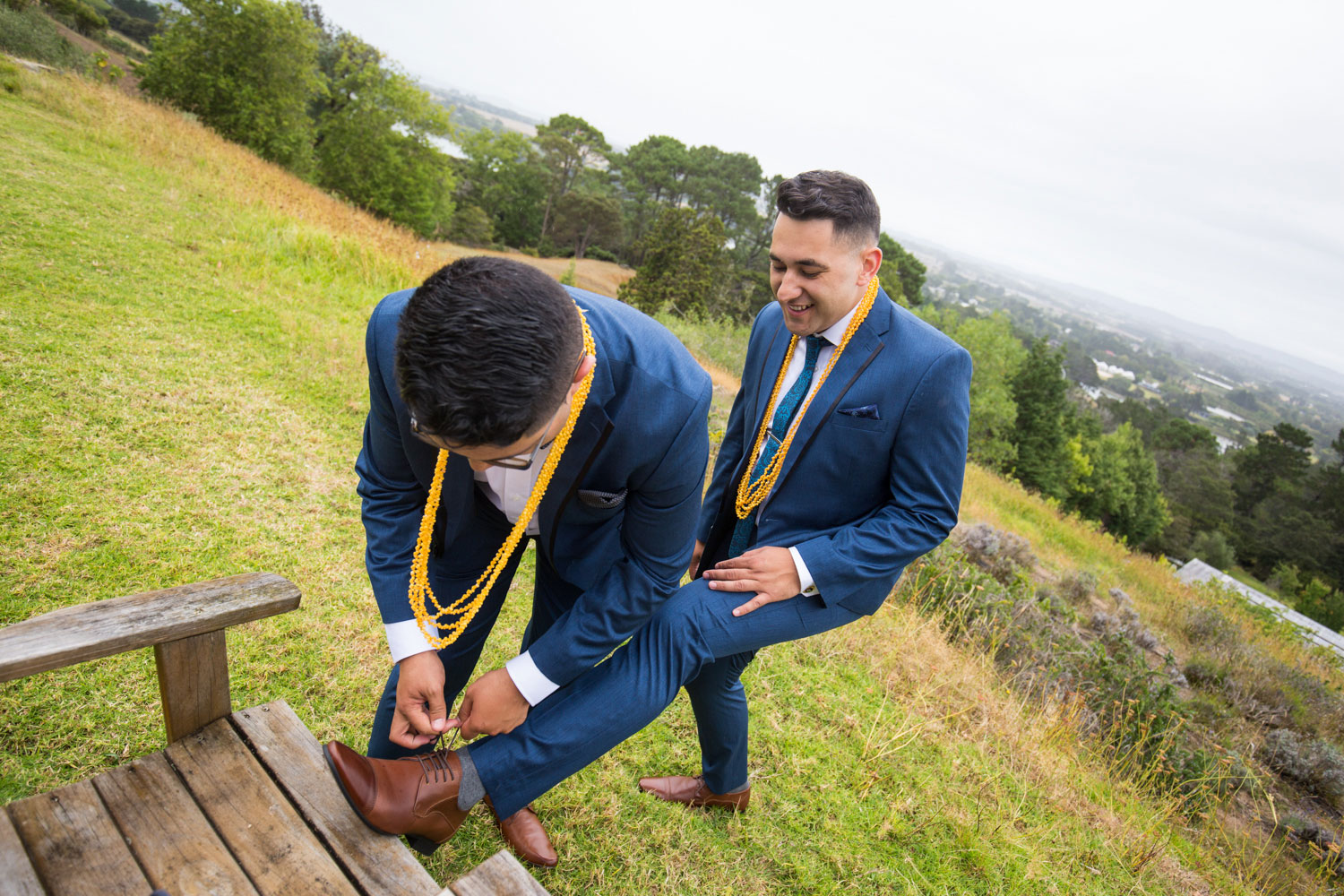 auckland wedding groom helping with shoes
