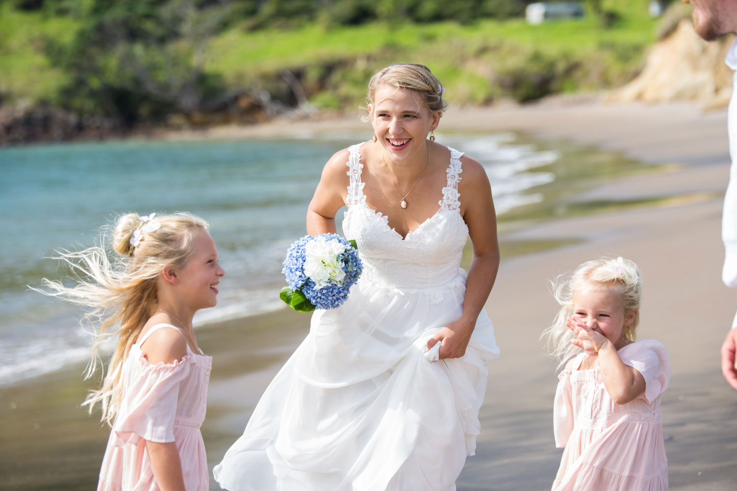 beach wedding bride laughing loud