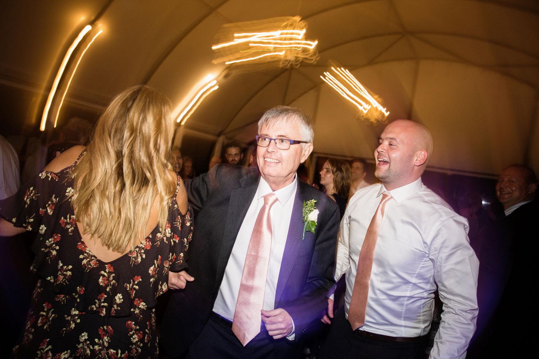 father of groom dancing