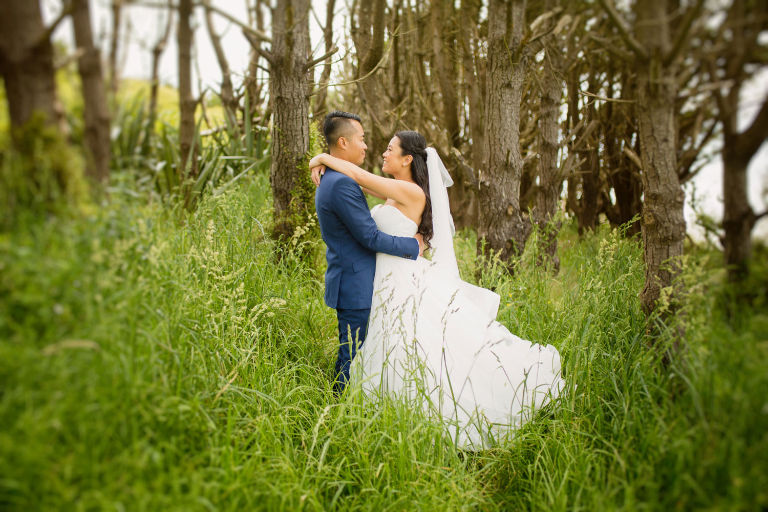castaways waiuku wedding bride and groom embrace