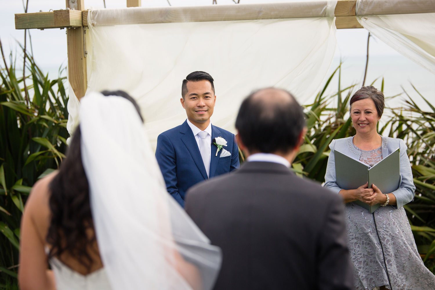 castaways waiuku wedding groom looking at bride