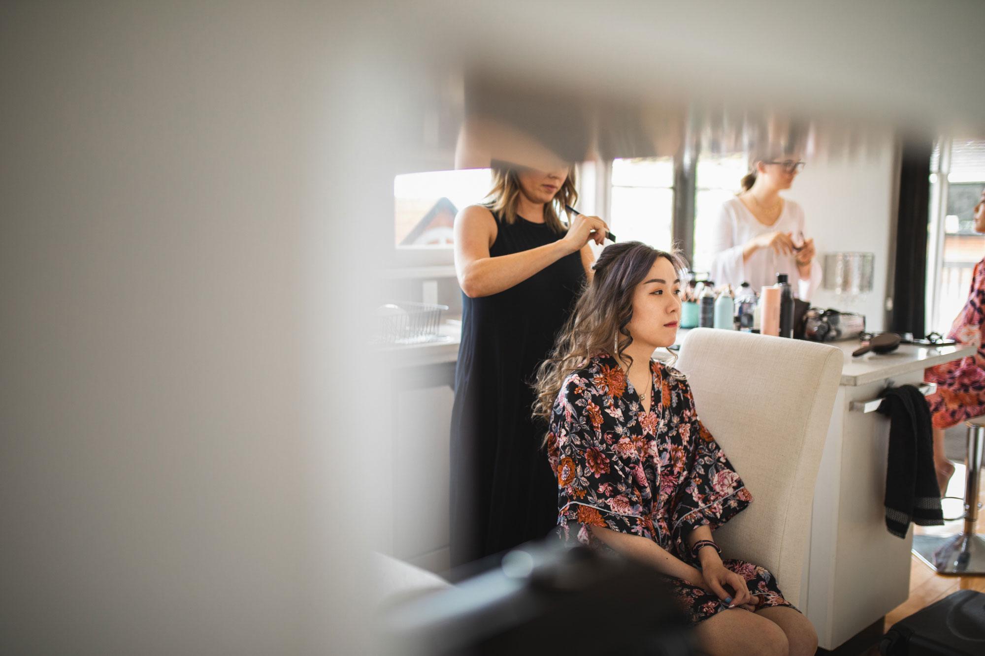bridesmaid getting make up done