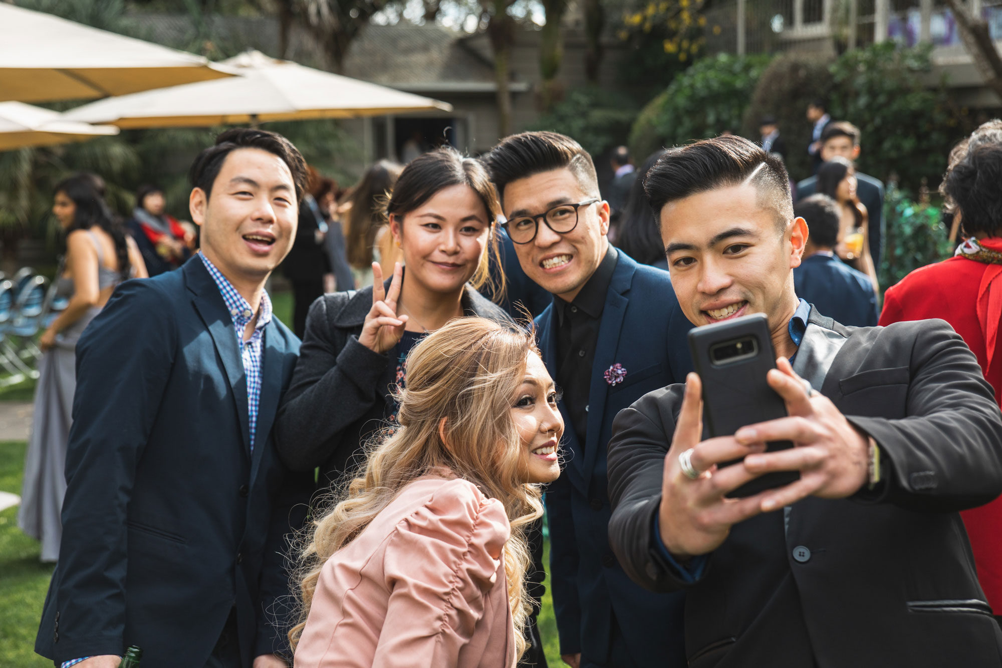 wedding guests taking a selfie