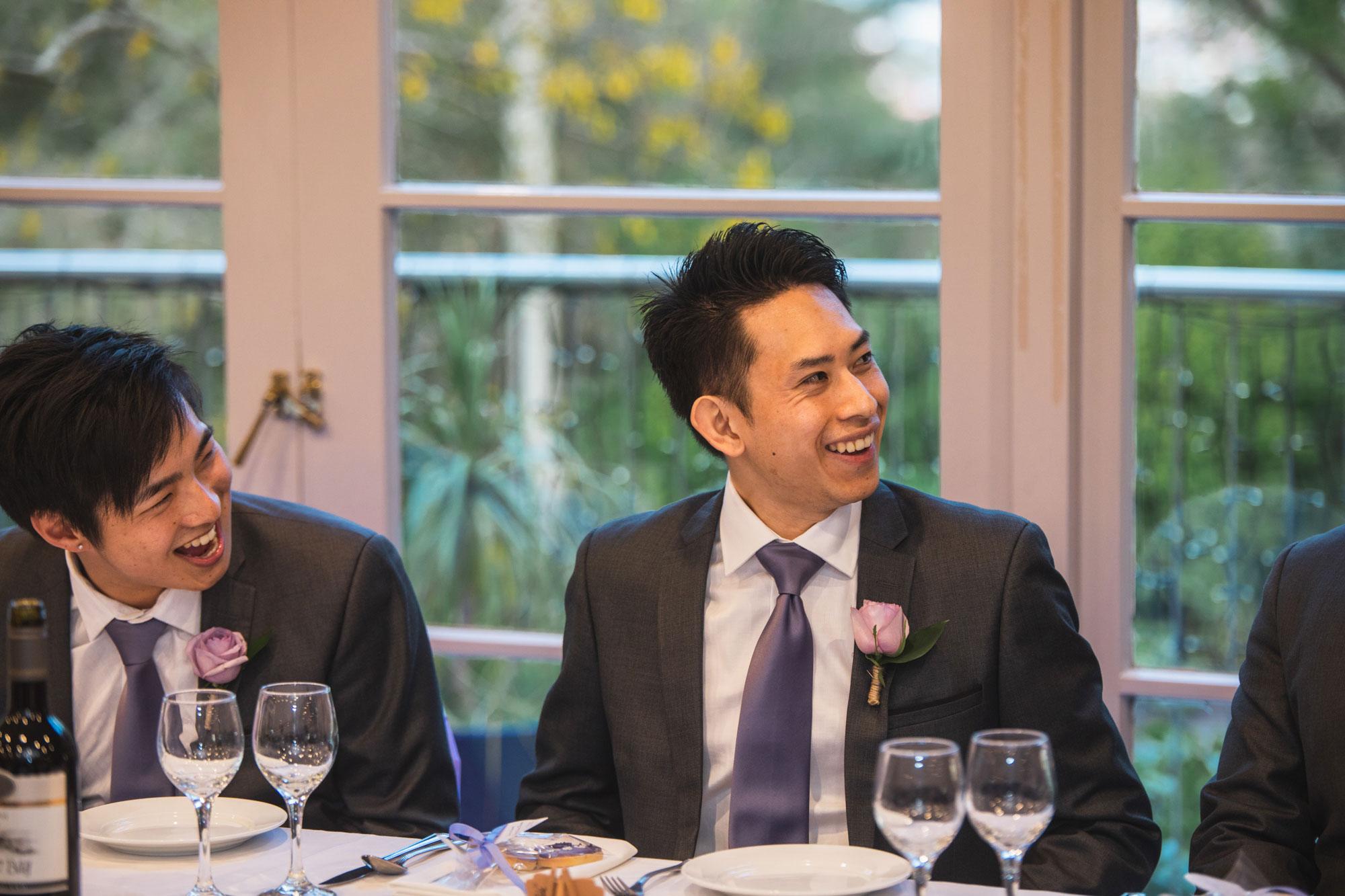 groomsman laughing at reception