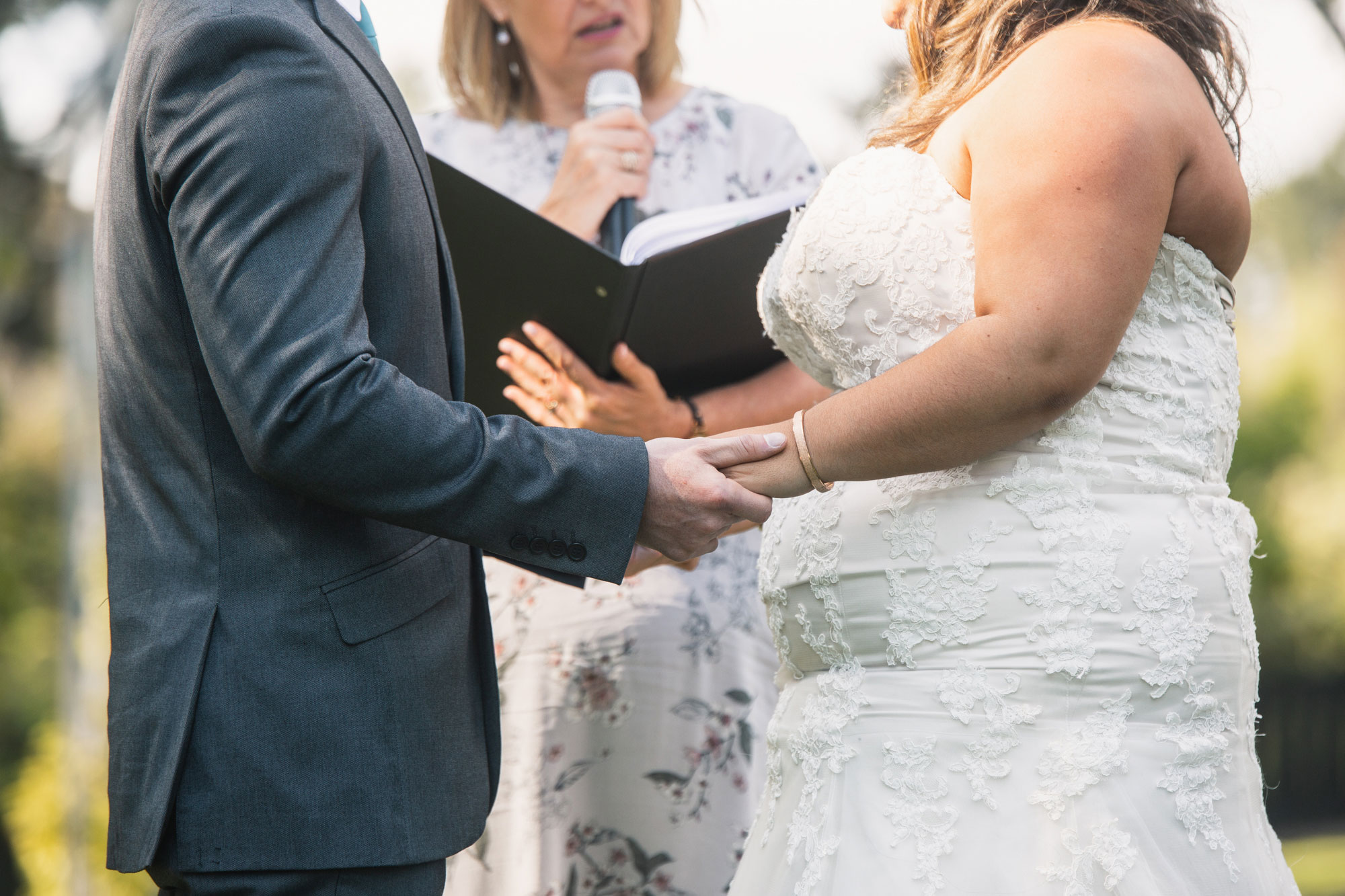 auckland wedding bride and groom holding hands
