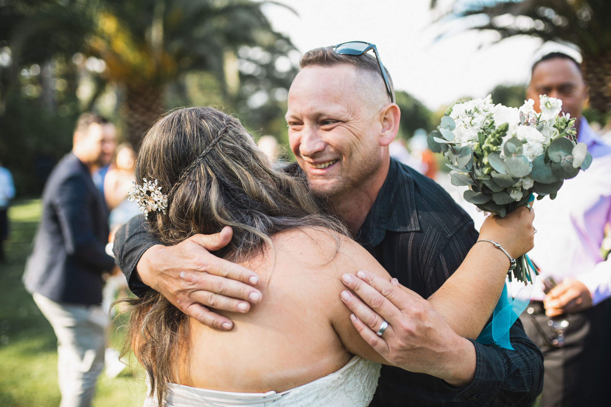 auckland wedding guest smiling