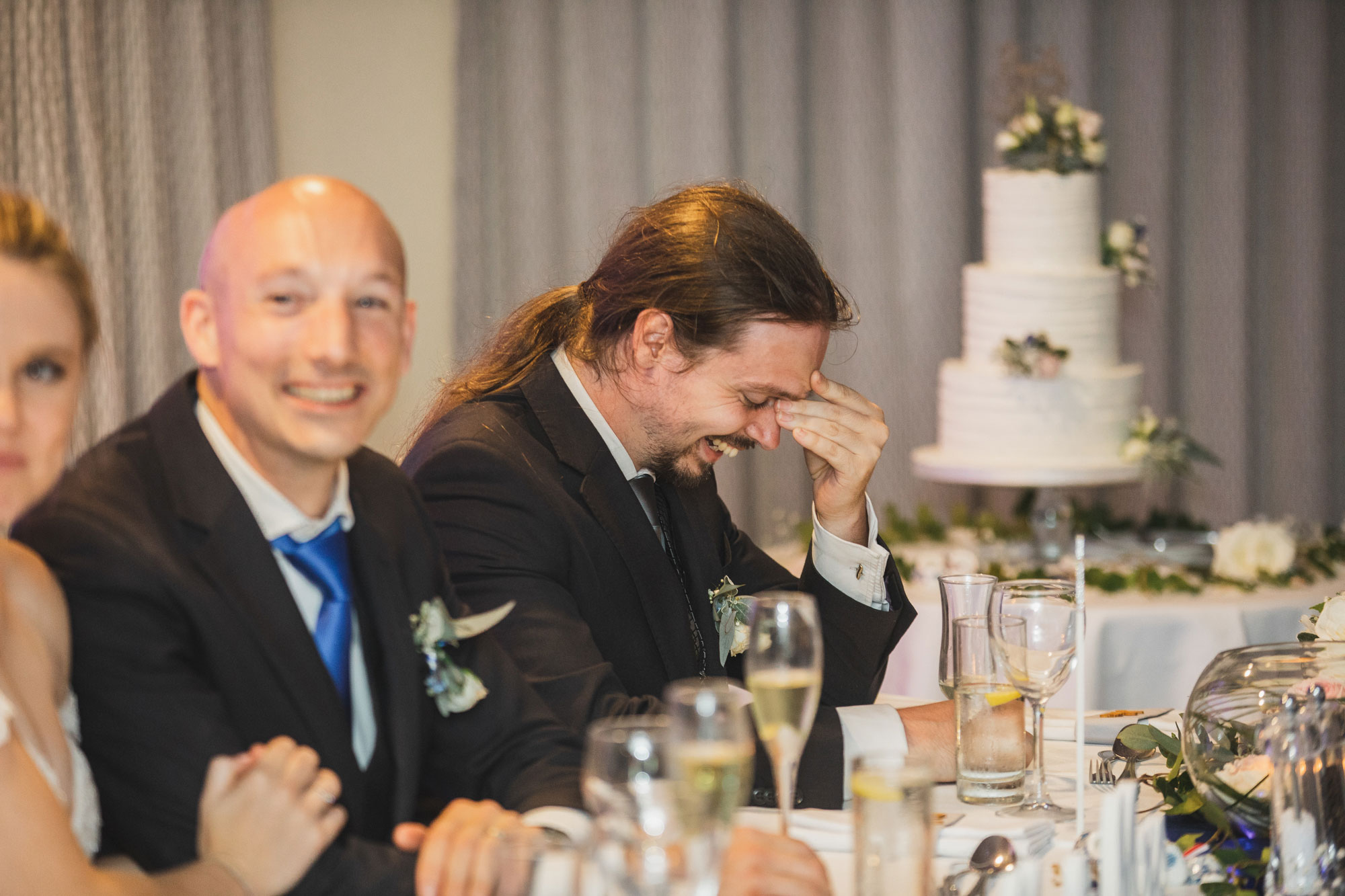 auckland wedding groomsman laughing