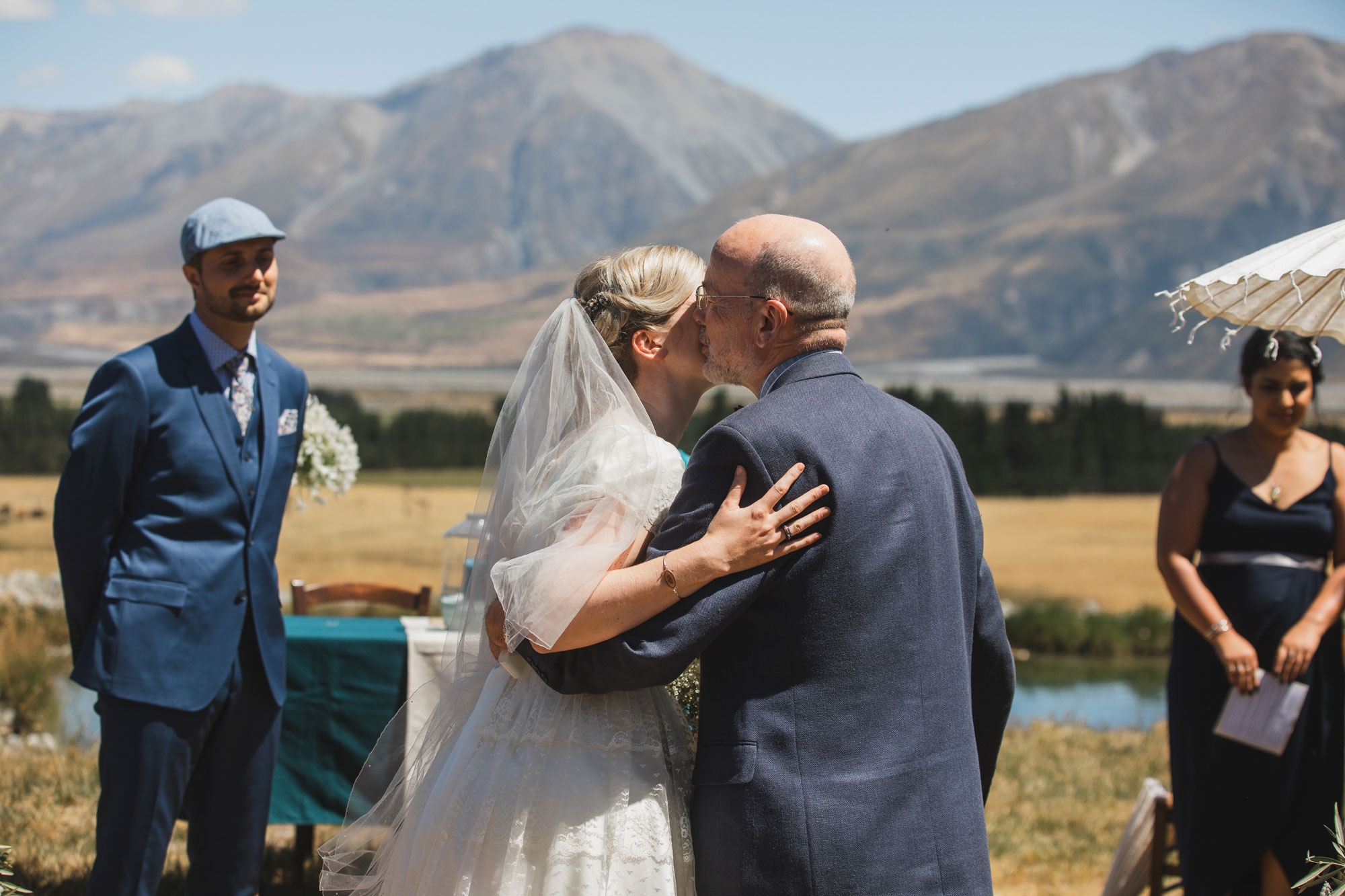 christchurch wedding bride and father hug