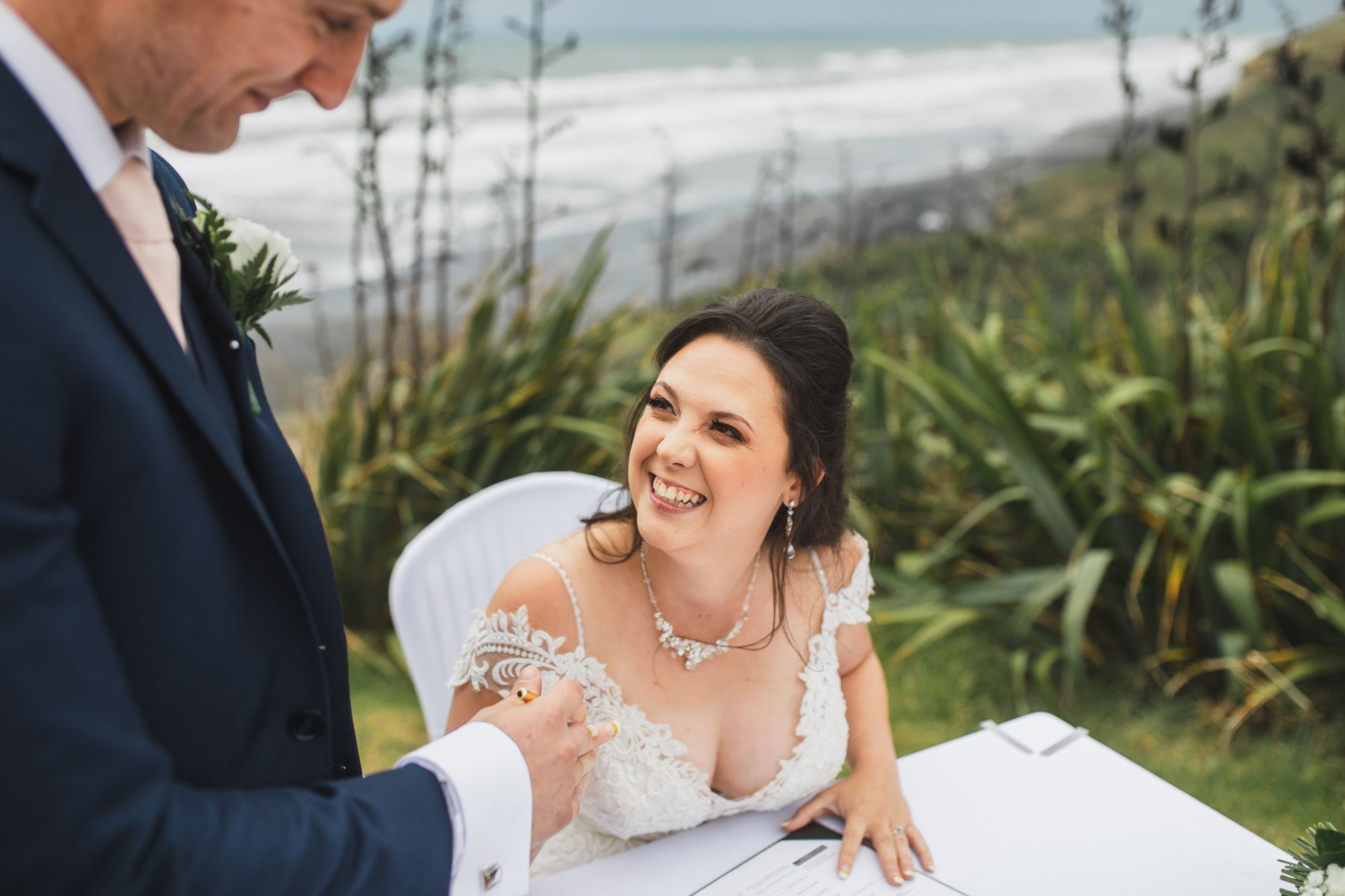 castaways waiuku wedding bride signing