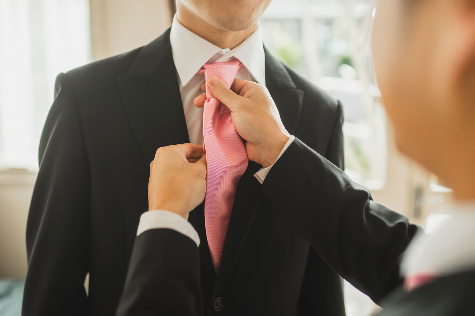 groom tie close up