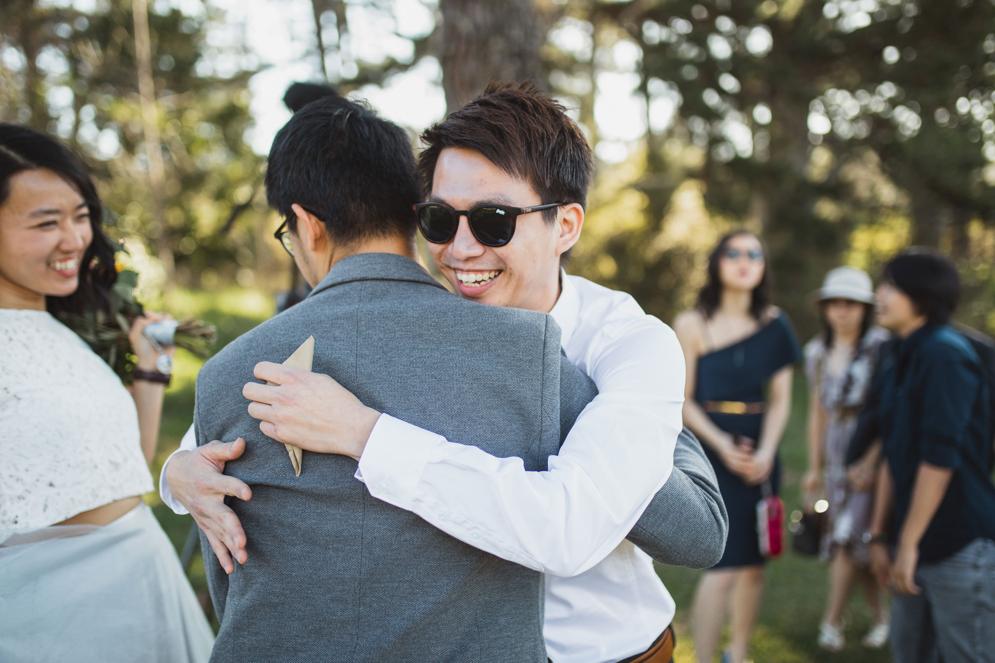 guest hugging the groom
