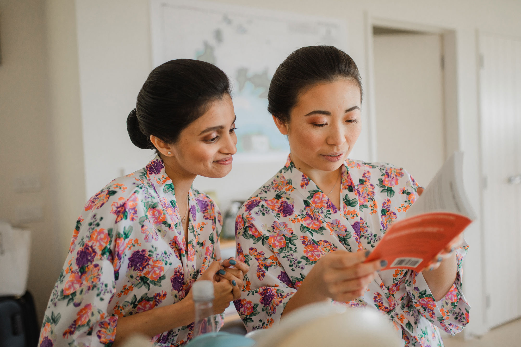 bridesmaids reading a book