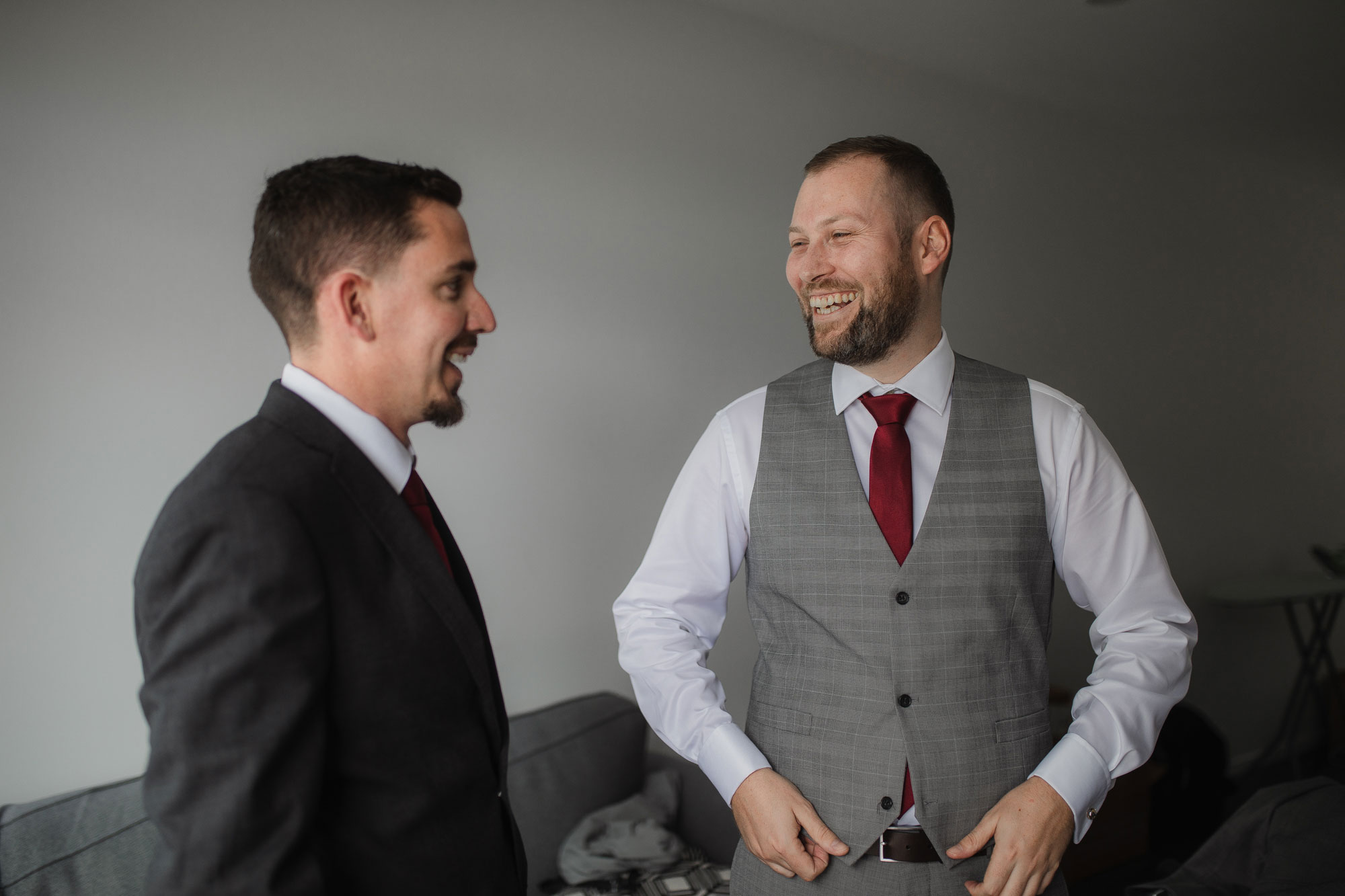 groom and groomsman smiling