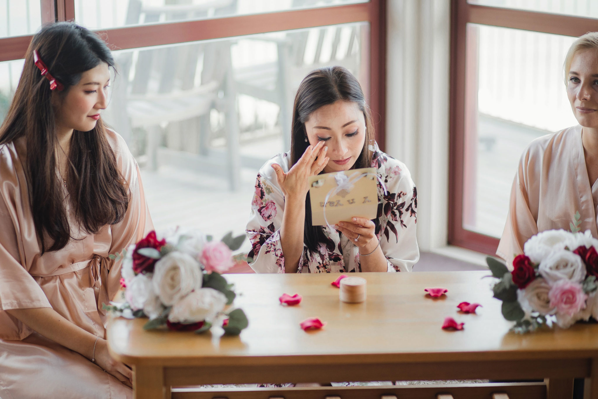 bride tearing up from reading letter