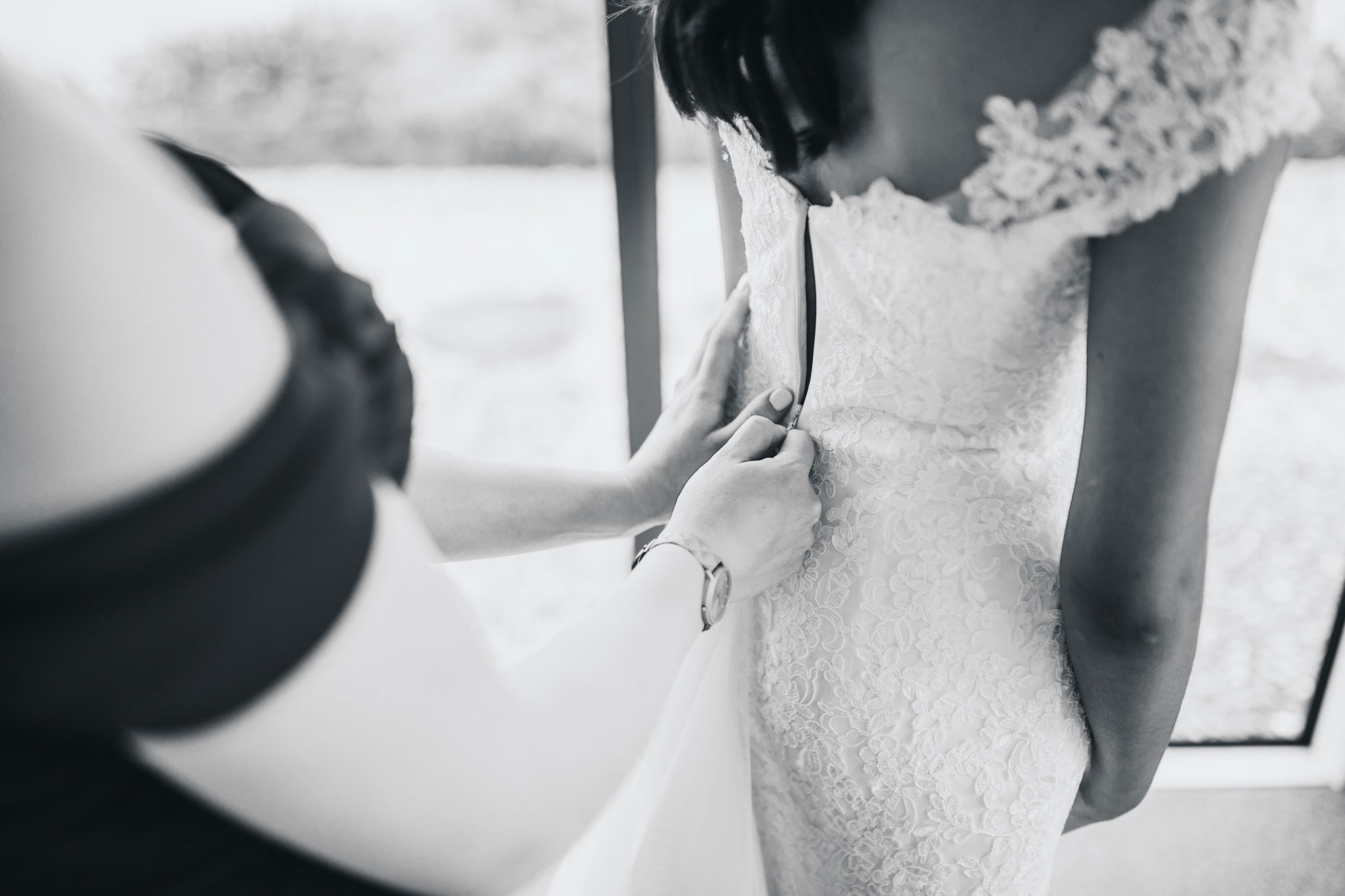 auckland bride getting into dress