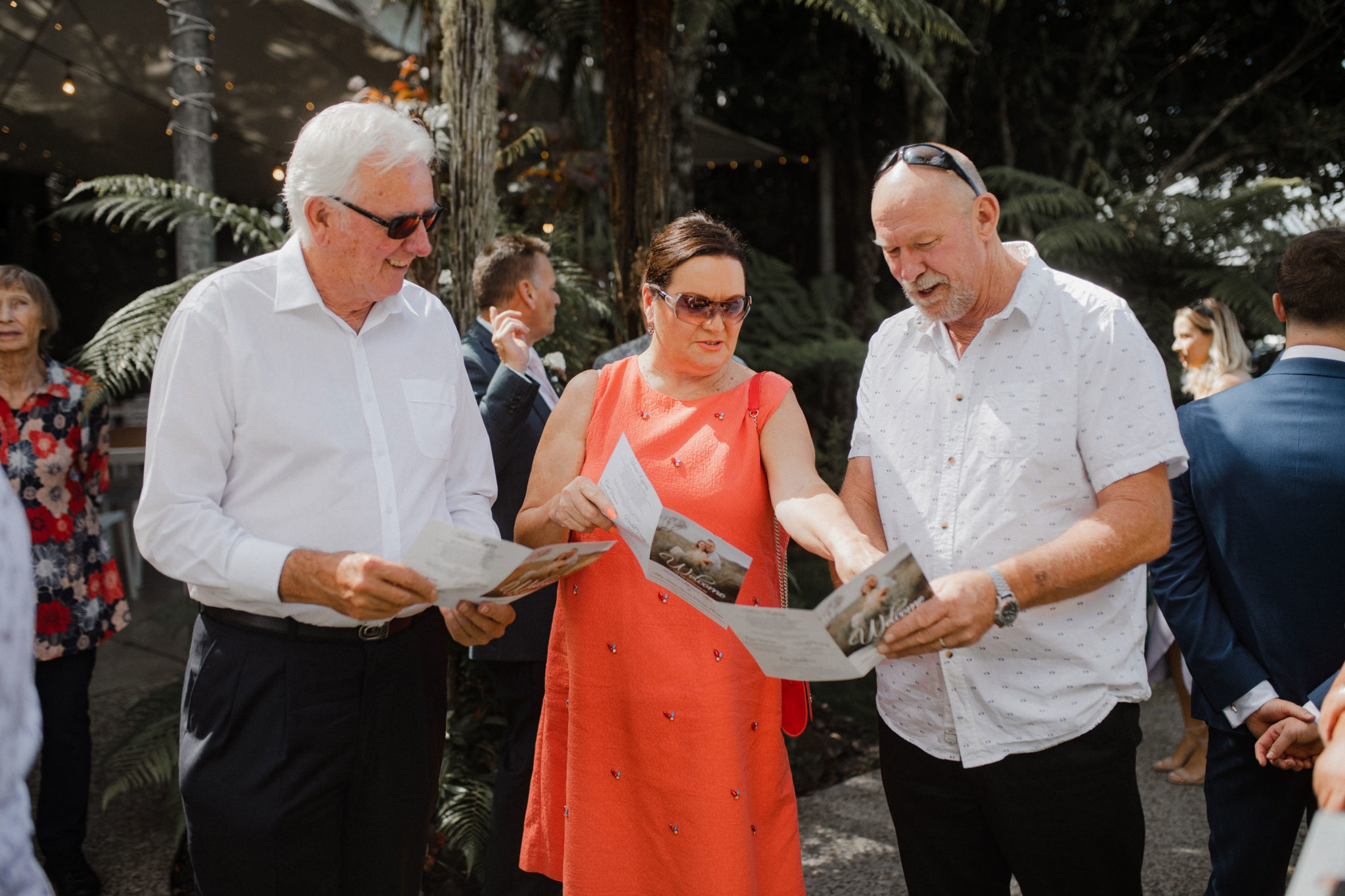 auckland wedding guests reading itinerary
